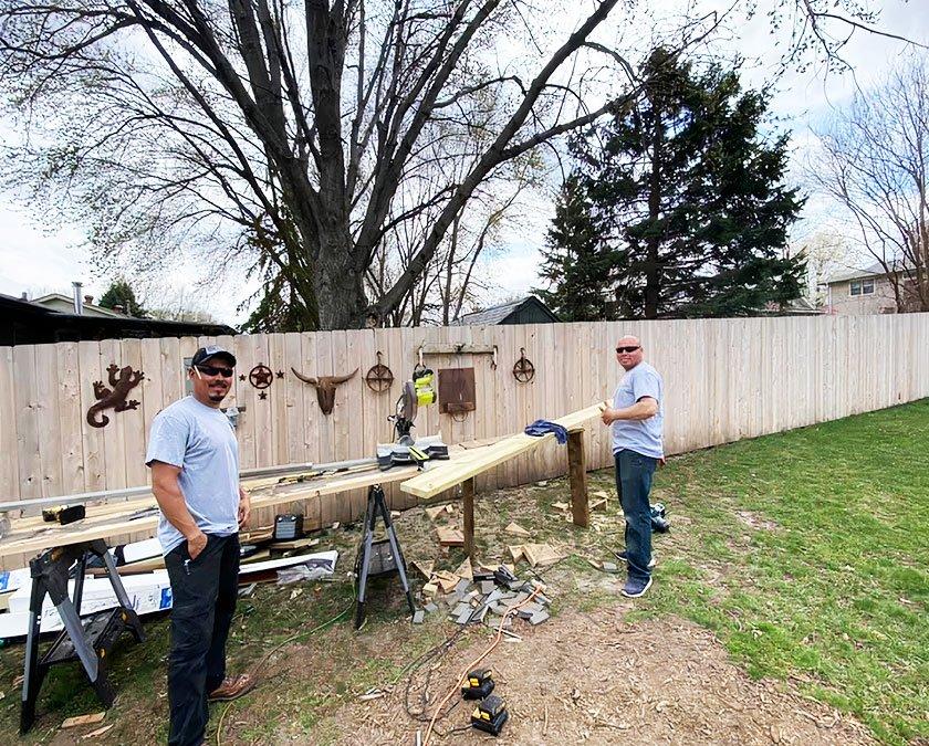 Team staff preparing wooden boards for custom deck building.